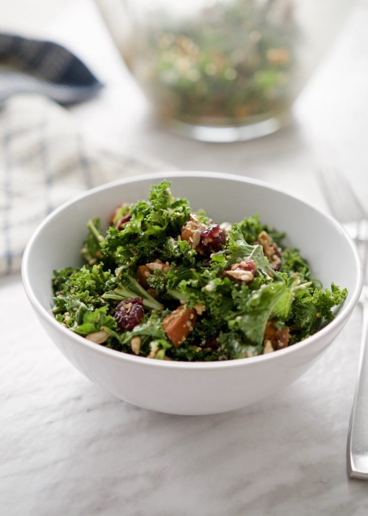 kale salad with dried cranberries and roasted sweet potato